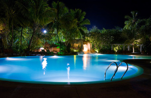 Pool and waterfall at night