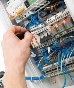 Commercial Electrician in Boynton Beach, working with electrical components